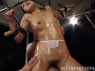 Oiled hottie Mayu Uchida tied up and pleasured by lot of dudes