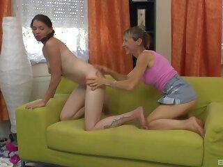 Lesbian bush-leaguer dealings on eradicate affect sofa between a younger and a mature babe